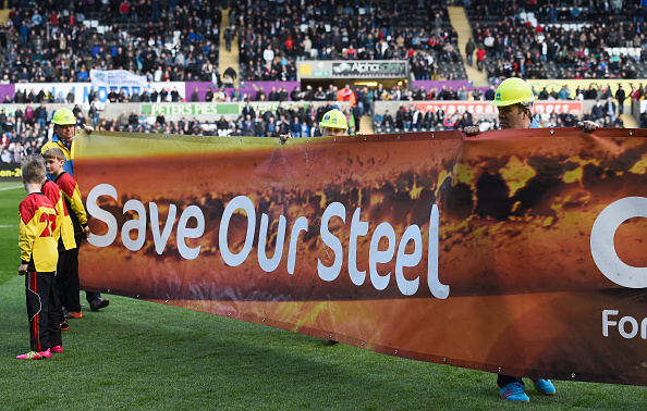 SWANSEA, UNITED KINGDOM - APRIL 09: Port Talbot steel workers holds a banner calling for support prior to the Barclays Premier League match between Swansea City and Chelsea at the Liberty Stadium on April 9, 2016 in Swansea, Wales. (Photo by Stu Forster/Getty Images)