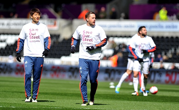 Swansea City's players wear Save Our Steel shirts Premier League match at the Liberty Stadium, Swansea.