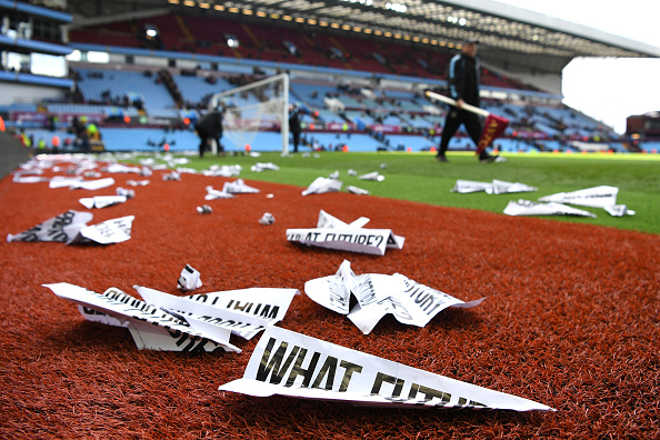 BIRMINGHAM, ENGLAND - APRIL 02: Protest banners scattered on the pitch after the Barclays Premier League match between Aston Villa and Chelsea at Villa Park on April 2, 2016 in Birmingham, England. (Photo by Shaun Botterill/Getty Images)